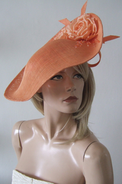 Apricot Peach Slice Flower Headpiece Hat. Ascot Hat Hire. Mother of the Bride Hats. London Hat Hire. Hat Hire Berkshire.