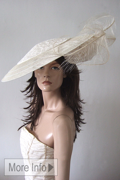 Dawn Guibert Cream Hat for Royal Ascot. Cream Mother of the Bride Hat. Large Cream Fascinator, Ascot Hat Hire. Cream Hat for Ascot. Hat rental for Royal Ascot. Mother of the Bride Hat Hire